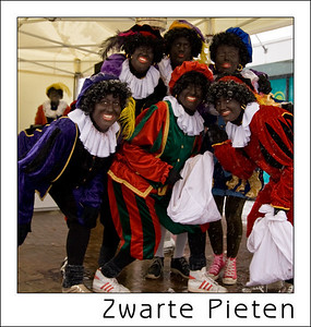Day 04 - Black Pete's  Sinterklaas is a typical dutch family tradtion, we celebrate his birthday on december 5th but the week before it is also celebrated in schools, offices, clubs, etc. and you can meet Black Pete's - Sint's helpers - all over in public places. more info : http://en.wikipedia.org/wiki/Sinterklaas