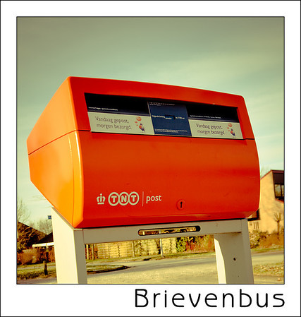 Day 01 - Mailbox  They used to be red for many many years but afte TNT took over they changed to orange. The royal crown stayed in the logo and as our royals surname is Orange we cannot mind that much.