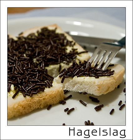 Day 02 - Chocolate Sprinkles  Best to be eaten with real butter on white bread. You can buy them in boxes and we have numerous brands that produce & sell them : http://www.deruijter.nl/producten/chocoladehagel-puur.aspx