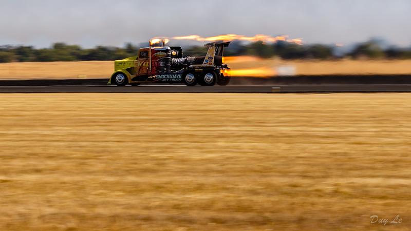 Shockwave Truck Racing Against Jet