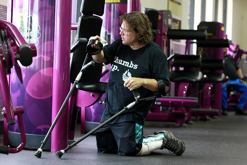 . Despite having cerebral palsy, Dwayne Boyd decided he wanted to start going to the gym for the first time at the age of 46. He started going to Planet Fitness in Leominster. He gets one of the machines ready to use. SENTINEL & ENTERPRISE/JOHN LOVE