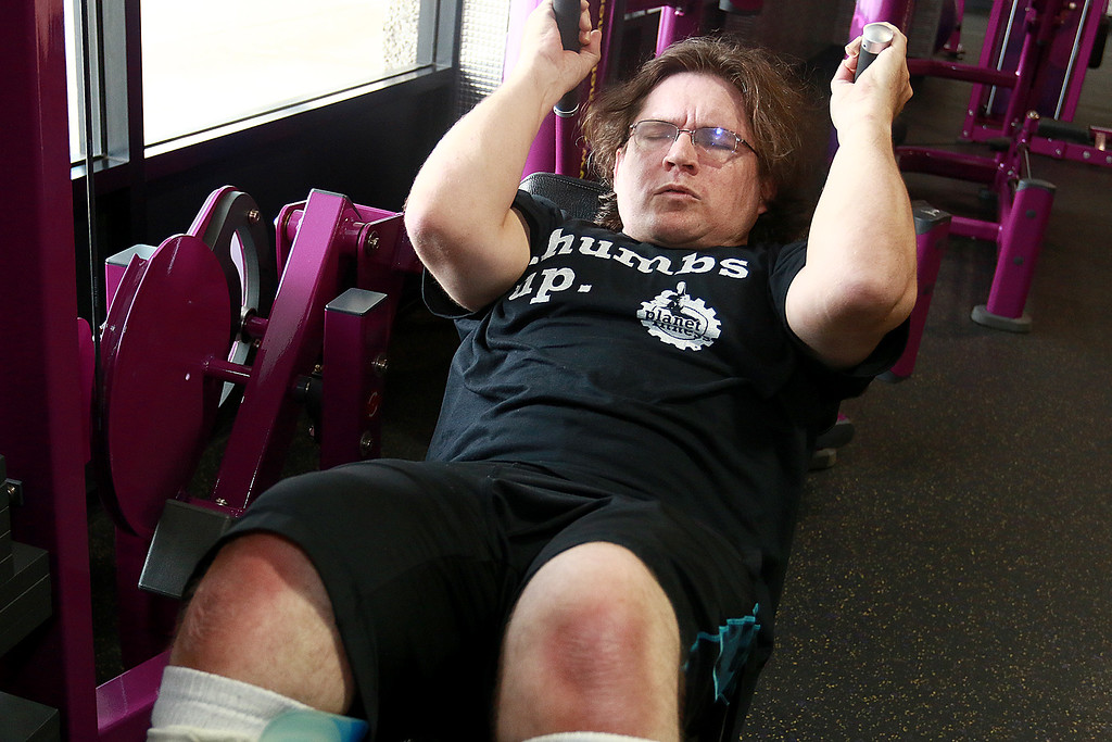 . Despite having cerebral palsy, Dwayne Boyd decided he wanted to start going to the gym for the first time at the age of 46. He started going to Planet Fitness in Leominster. Here he works out on his abs doing crunches. SENTINEL & ENTERPRISE/JOHN LOVE