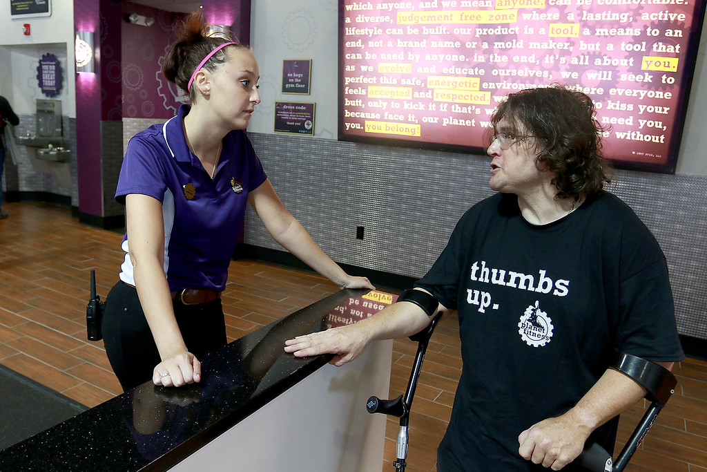 . Despite having cerebral palsy, Dwayne Boyd decided he wanted to start going to the gym for the first time at the age of 46. He started going to Planet Fitness in Leominster. On his way out after working out Assistant Manager Laura Bursch, 27, chats with Boyd to see how his workout was. SENTINEL & ENTERPRISE/JOHN LOVE