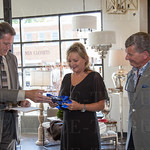 Mike Chesser awards a plaque to the owners of Dwellings, Donna Outaw and Shane Pearson, on behalf of the St. Matthews Chamber