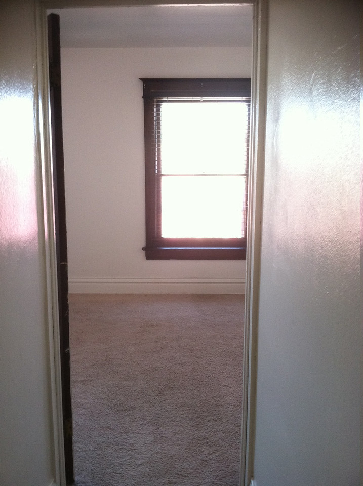 view into master bedroom from the upstairs hallway