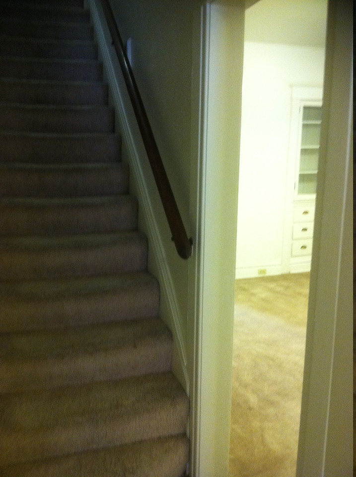 stair way and door to dining room from front hall