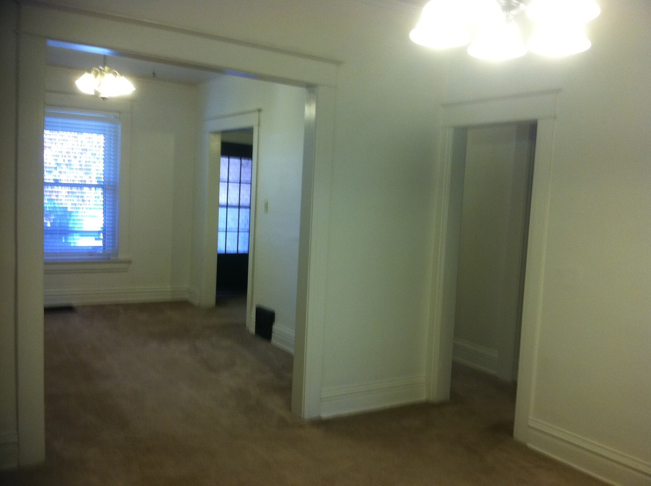 view of front room and hallway from dining room