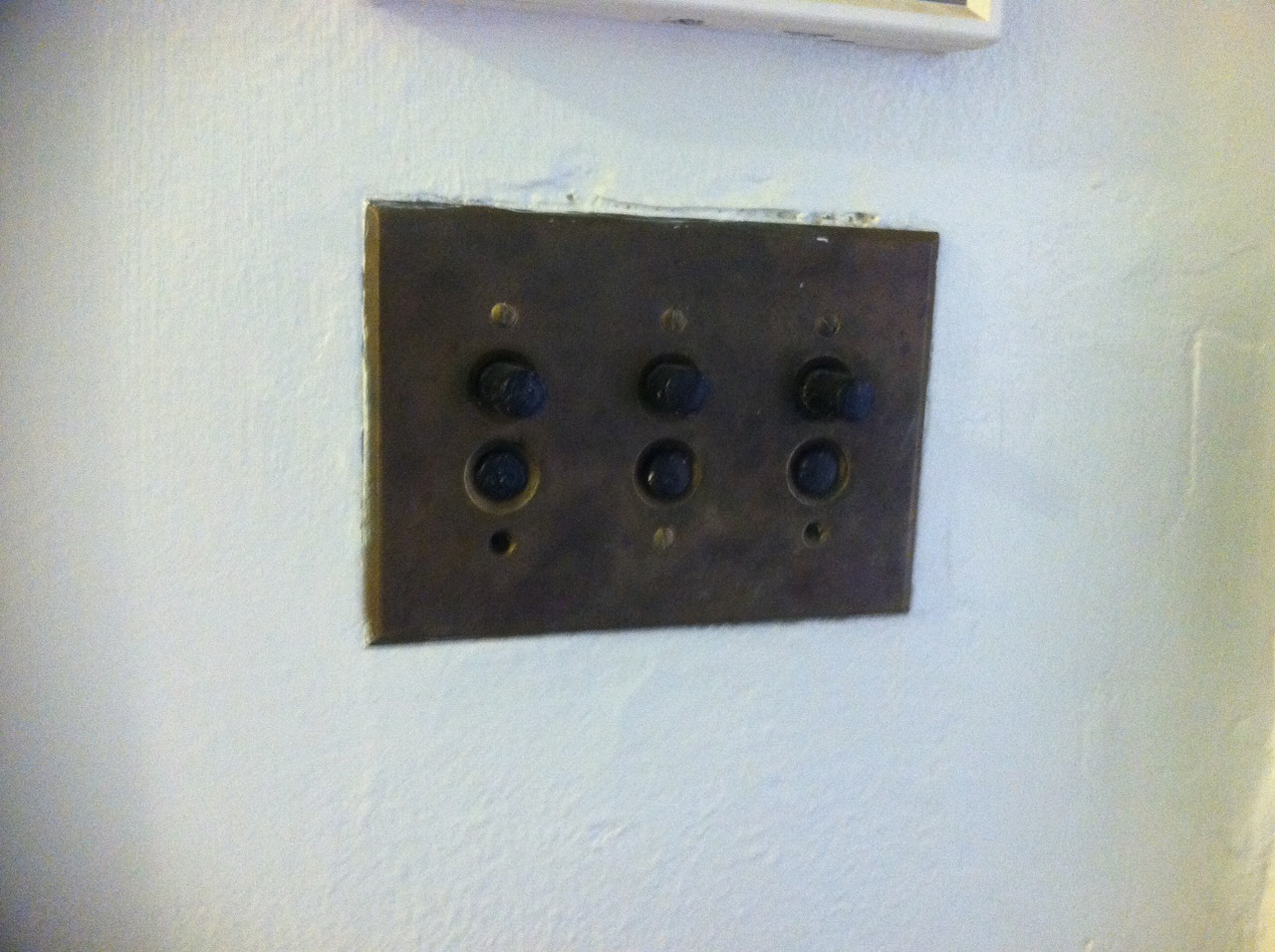 push button light switches--they're pretty cool!  i'd never seen any of these preserved in a house before