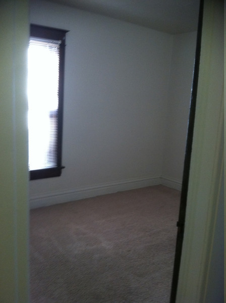 2nd room--middle of the 3 bedrooms....this is one option for our bedroom.  has the best closet of the three rooms