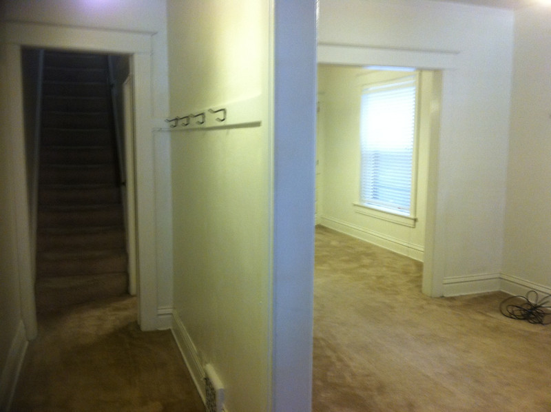 view of front room and hall from front door