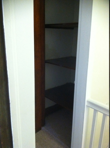hall closet--a lot deeper than you can see