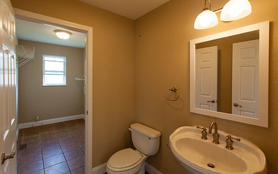 Half bathroom off main living area and connected to laundry closet/mudroom