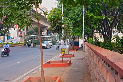 Street scene with brick fence