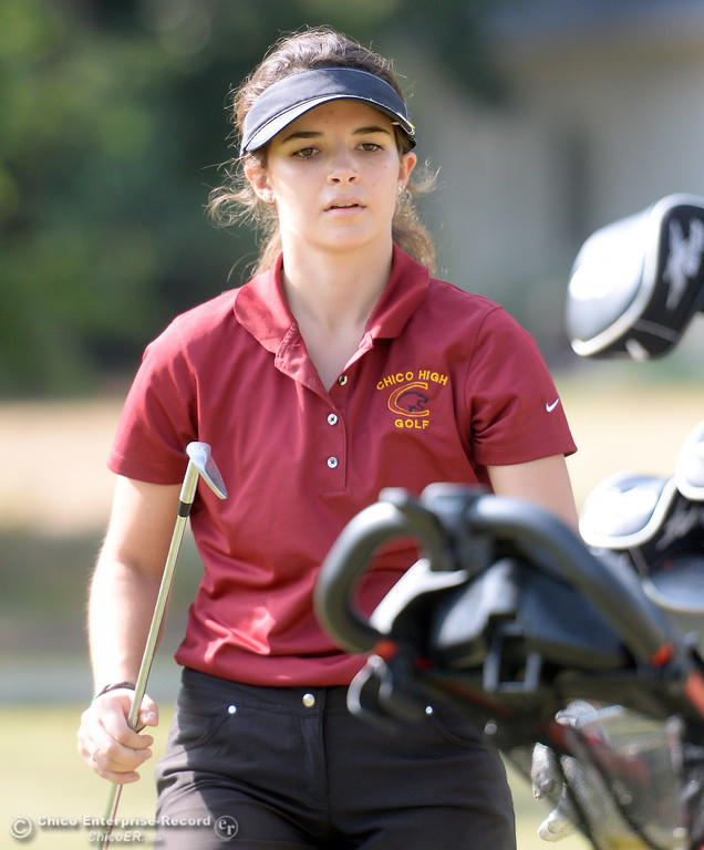 . Chico High golfer Mary Skillcorn selects a club during the Eastern Athletic- Sacramento River League girls golf championships at Butte Creek Country Club in Chico, Calif. Monday Oct. 16, 2017. (Bill Husa -- Enterprise-Record)