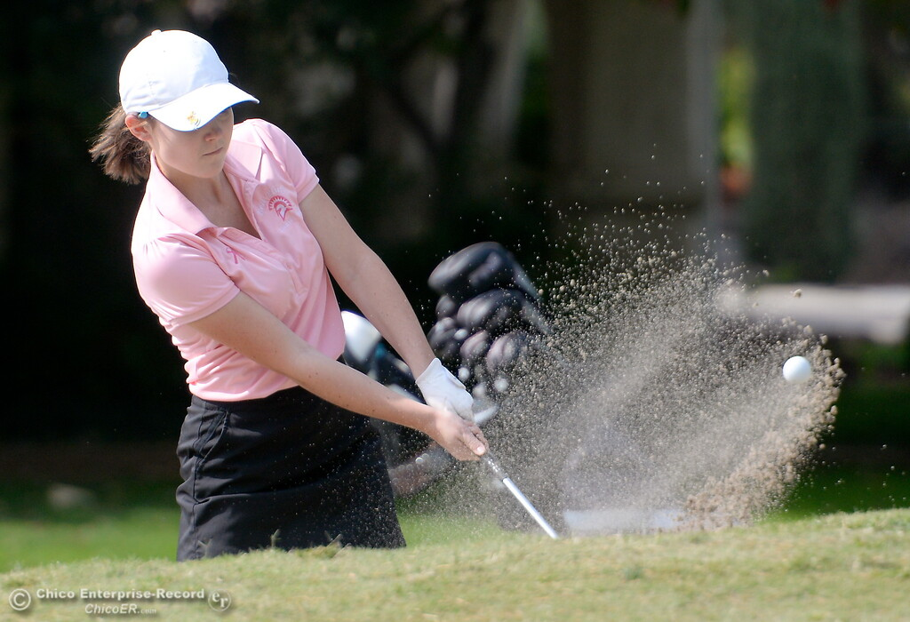 . Red Bluff golfer Hannah Huhn rips one out of the bunker on the 10th hole during the Eastern Athletic- Sacramento River League girls golf championships at Butte Creek Country Club in Chico, Calif. Monday Oct. 16, 2017. (Bill Husa -- Enterprise-Record)