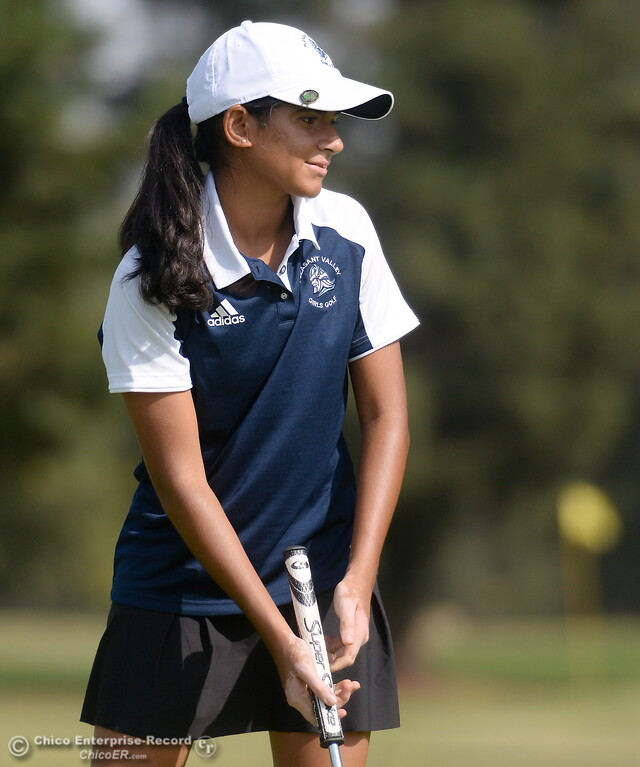 . PV golfer Kiran Singh watches her putt during the Eastern Athletic- Sacramento River League girls golf championships at Butte Creek Country Club in Chico, Calif. Monday Oct. 16, 2017. (Bill Husa -- Enterprise-Record)