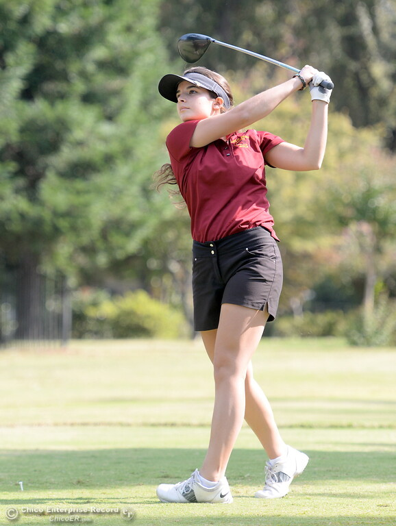 . Chico High golfer Mary Skillcorn watches her drive on the 9th hole during the Eastern Athletic- Sacramento River League girls golf championships at Butte Creek Country Club in Chico, Calif. Monday Oct. 16, 2017. (Bill Husa -- Enterprise-Record)