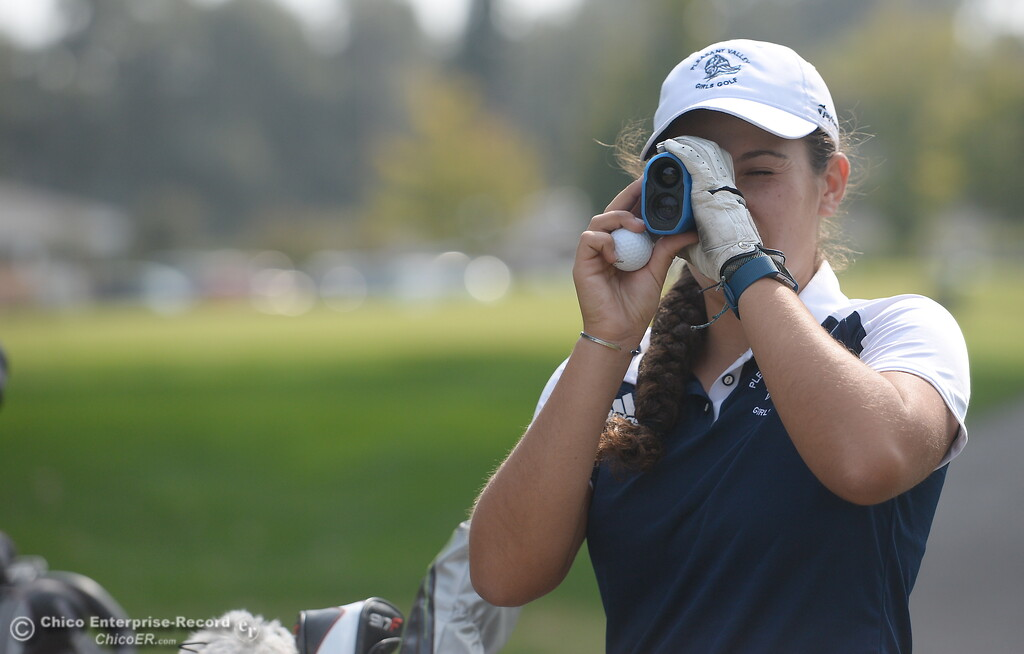 . PV Golfer Jackie Lucena checks distance on the 10th hole before her tee shot during the Eastern Athletic- Sacramento River League girls golf championships at Butte Creek Country Club in Chico, Calif. Monday Oct. 16, 2017. (Bill Husa -- Enterprise-Record)