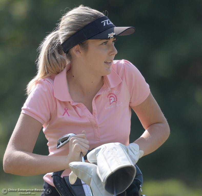 . Red Bluff golfer Karli Rodriguez selects a club during the Eastern Athletic- Sacramento River League girls golf championships at Butte Creek Country Club in Chico, Calif. Monday Oct. 16, 2017. (Bill Husa -- Enterprise-Record)