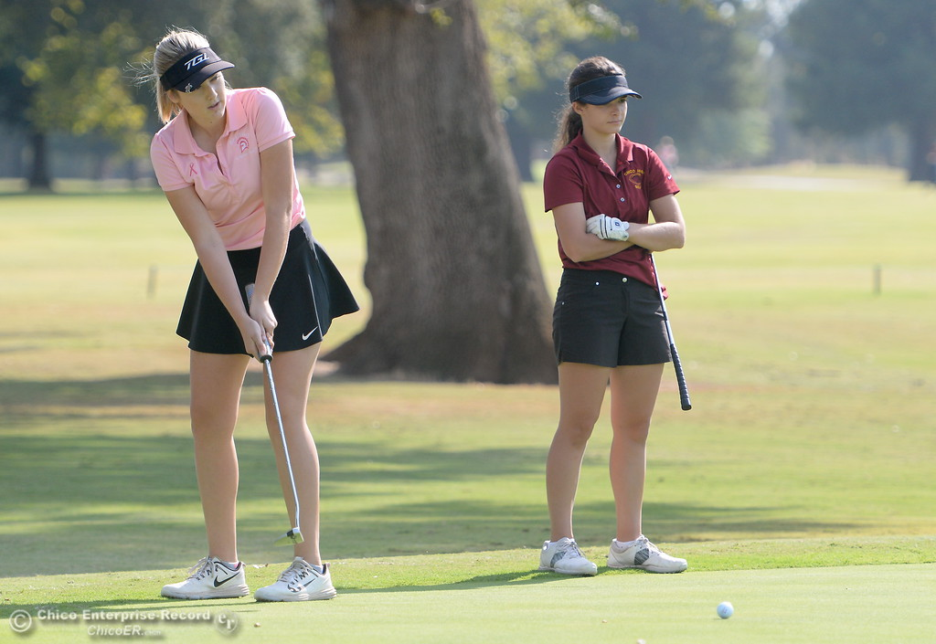. Red Bluff golfer Karli Rodriguez putts while Chico High\'s Mary Skillcorn looks on during the Eastern Athletic- Sacramento River League girls golf championships at Butte Creek Country Club in Chico, Calif. Monday Oct. 16, 2017. (Bill Husa -- Enterprise-Record)