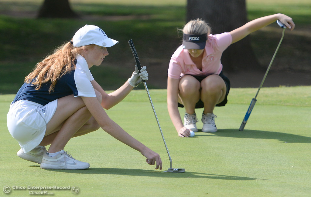 . PV golfer Erin Milliken left and Red Bluff golfer Karli Rodriguez line up their putts on the 9th hole during the Eastern Athletic- Sacramento River League girls golf championships at Butte Creek Country Club in Chico, Calif. Monday Oct. 16, 2017. (Bill Husa -- Enterprise-Record)