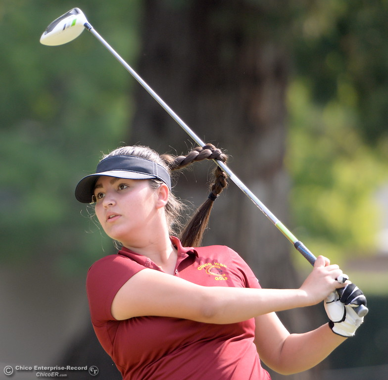 . Chico High Golfer Sophia Magana watches her drive on the 10th hole during the Eastern Athletic- Sacramento River League girls golf championships at Butte Creek Country Club in Chico, Calif. Monday Oct. 16, 2017. (Bill Husa -- Enterprise-Record)