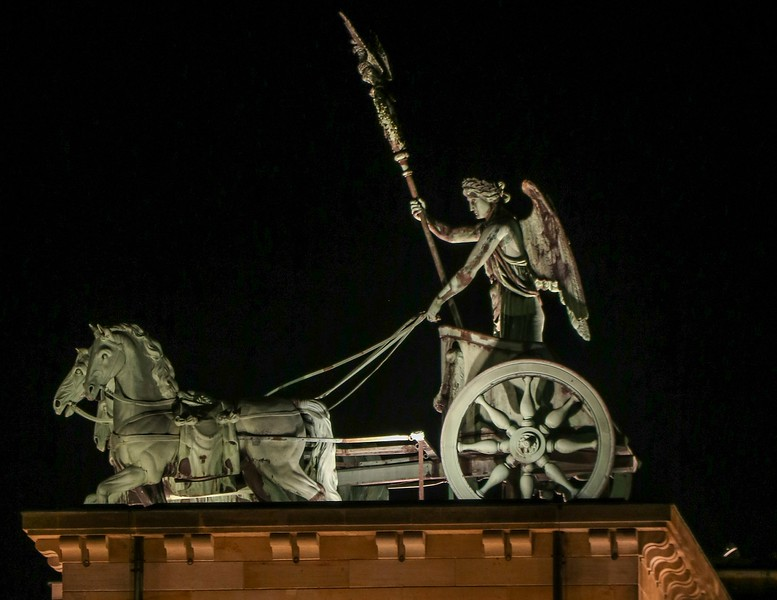 """The Brandenburg Gate's 4 horse statue, called a quadriga, was """"lifted' by Napoleon and taken to Paris in 1806, but was returned later. The original sculpture was eroding, and placed in a museum. This is a 1980's replica."""