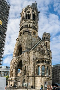 Remains of the original Kaiser Wilhelm Church in Berlin. Its stubborn resistance to a devastating 1943 bombing raid endeared it to Berliners.  Public pressure in 1947 forced the reconstruction architect to save what was left and build the new church next door.