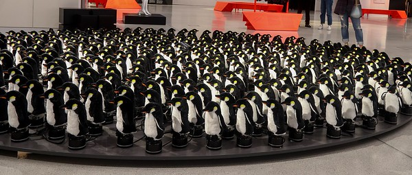 This animated Penguin sculpure in a Berlin Lamborghini dealership has all the Penguins moving periodically around the platform in various formations as their bodies spin and wiggle with heads turning. Whimsical and fun to watch.