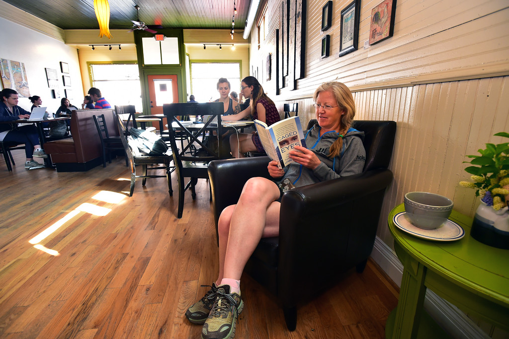 . Megan Finnesy of Lafayette enjoys a drink and book at the East Simpson Coffee Company on Wednesday morning in Lafayette. For more photos go to www.dailycamera.com Paul Aiken Staff Photographer April 19, 2017