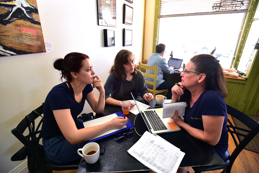 . Co Owner Leslie Wing-Pomeroy, right, holds a staff meeting with managers Mattie Pomeroy, left and Emiliy Plummer at the East Simpson Coffee Company on Wednesday morning in Lafayette. For more photos go to www.dailycamera.com Paul Aiken Staff Photographer April 19, 2017