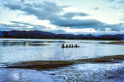 Boys on flooded Dak Bla river