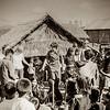 Jar party in a village. Western staff dancing.