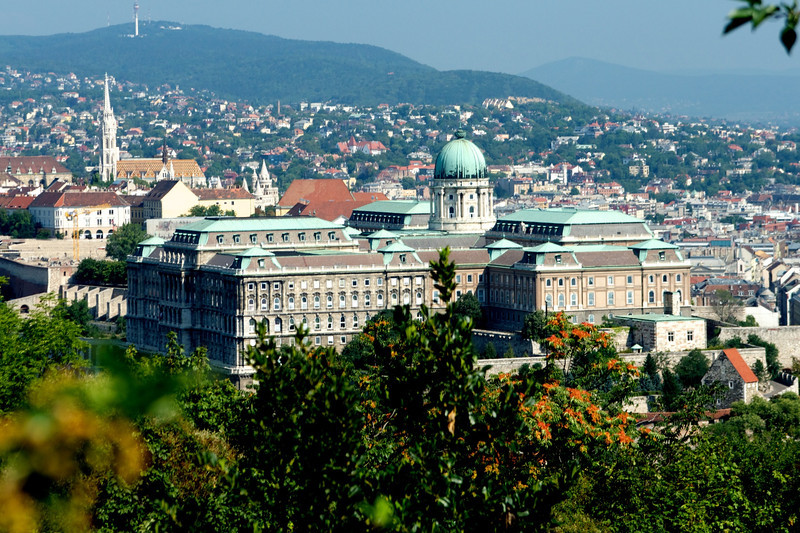 The copper dome of Buda Castle which houses the Hungarian National Gallery is shown at the center.  The Church of Our Lady (St. Mathias) and Fisherman's Bastion are at left.