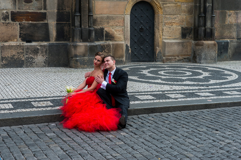 Many couples travel to Prague for unique wedding photos.