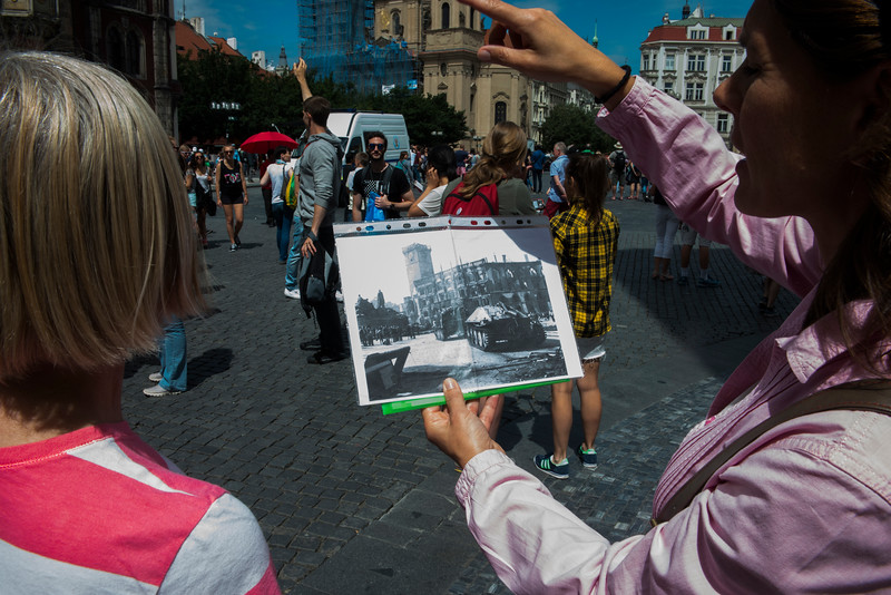 Guide Marketa shows a photo of the town Hall prior to destruction by the Nazis.