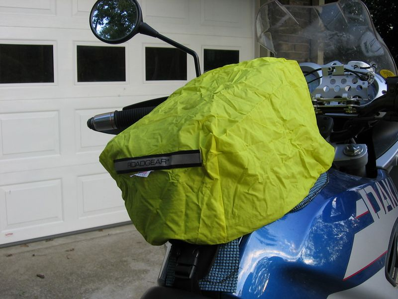 I haven't pulled the drawstring taut; it's just pulled over the tankbag for the picture. I've never had any tankbag contents get wet in any of my rainy-day rides.