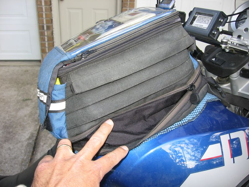 Opening this zipper will expand the tankbag capacity by about three liters.