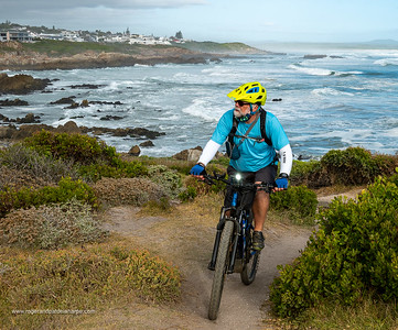 Image Number GM5R385288. Roger de la Harpe, ebiking at Skulpiesbaai with views across Walker Bay. Hermanus. Whale Coast. Overberg. Western Cape. South Africa