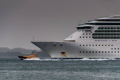 Port of Cork Pilot Boat, Fáilte, races ahead of the Cruise Liner, Serenade of the Seas, as it departs Cork Harbour.