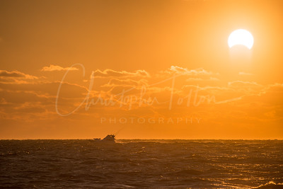 Boat Passing Partial Eclipse of the Sun