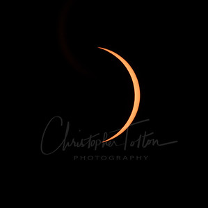 TOTALITY ENDS AND SOLAR FILTER SHOWS AN ORANGE CRESCENT