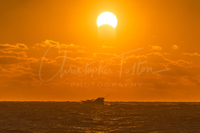Boat Under a Solar Eclipse