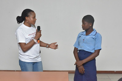 Founder of Hopes and Dreams Initiatives interacting with a student on menstural hygiene