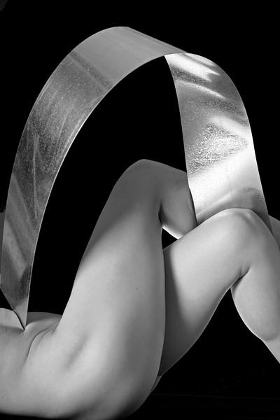 Legs Crossed Steel