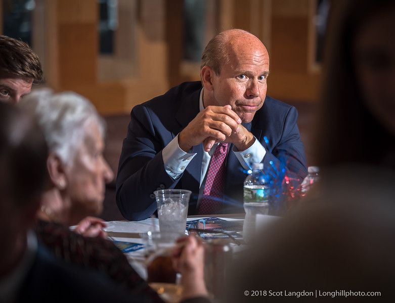 Rep. John K. Delaney (D) from Maryland, is an American politician and businessman as United States Representative for Maryland's 6th congressional district since 2013 and is running for President of the United States in 2020.  Mr. Delaney attended and spoke with voters at a Manchester (NH) Democrats dinner on June 16, 2018.  Here he listens to NH voter's concerns prior to his keynote speech. (c) Scot Langdon