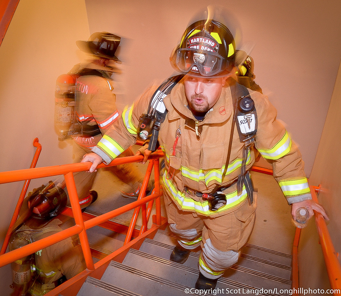 """Manchester, NH - Fire fighters from all over New England participated in the NH 9-11 Memorial Stair climb. For the complete picture story from the day see >> <a href=""""http://smu.gs/WnZH3j"""">http://smu.gs/WnZH3j</a>"""