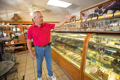 John Button describes his Rocky Mountain Chocolate Factory store layout in downtown Paso Robles. John and his wife Debbie sold their million dollar home in Danville to buy one half the price on a bigger lot in Paso Robles, where they now own a chocolate shop. Their grandkids live three blocks away and are a big part of their lives. John who worked in high tech, is semi-retired, and likes to ride his motorcycles on the backroads of Paso Robles and up and down the coast. Debbie really likes working at the chocolate shop which they purchased after moving to Paso Robles.