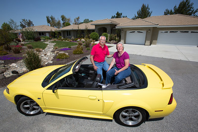 Their relationship started as high school sweathearts and now John and Debbie Button sit in Debbie's yellow Mustang convertible in front of their Paso Robles home. The Buttons sold their million dollar home in Danville to buy one half the price on a bigger lot in Paso Robles, where they now own a chocolate shop. Their grandkids live three blocks away and are a big part of their lives. John who worked in high tech, is semi-retired, and likes to ride his motorcycles on the backroads of Paso Robles and up and down the coast. Debbie really likes working at the chocolate shop which they purchased after moving to Paso Robles.