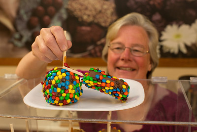 One of the delicious treats John and Debbie Button serve at their Rocky Mountain Chocolate Factory store in downtown Paso Robles is caramel apples and chocolate marshmellows dipped in m&ms.